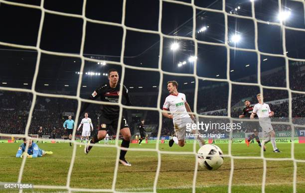 Javier Hernandez of Leverkusen scores the third goal during the Bundesliga match between FC Augsburg and Bayer 04 Leverkusen at WWK Arena on February...