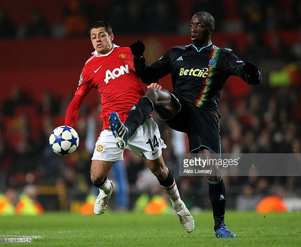 Javier Hernandez of Manchester United battles for the ball with Souleymane Diawara of Marseille during the UEFA Champions League round of 16 second...