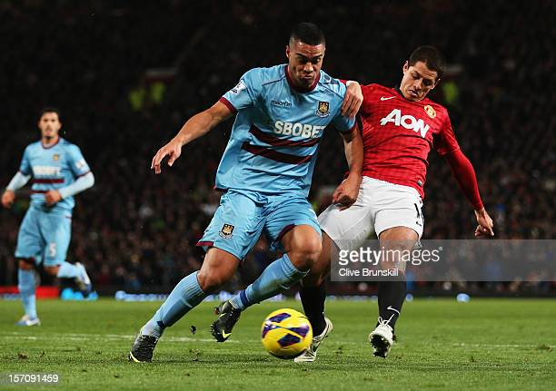 Javier Hernandez of Manchester United battles with Winston Reid of West Ham United during the Barclays Premier League match between Manchester United...