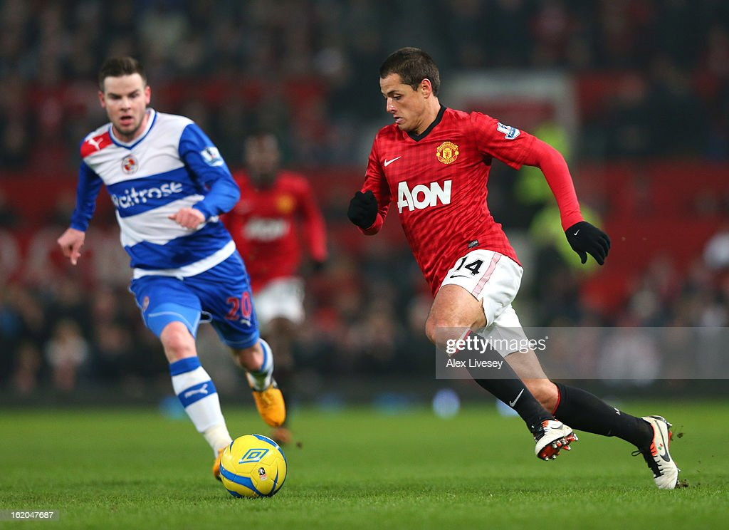 <a gi-track='captionPersonalityLinkClicked' href=/galleries/search?phrase=Javier+Hernandez+-+Soccer+Player&family=editorial&specificpeople=6733186 ng-click='$event.stopPropagation()'>Javier Hernandez</a> of Manchester United beats <a gi-track='captionPersonalityLinkClicked' href=/galleries/search?phrase=Danny+Guthrie&family=editorial&specificpeople=747593 ng-click='$event.stopPropagation()'>Danny Guthrie</a> of Reading during the FA Cup Fifth Round match between Manchester United and Reading at Old Trafford on February 18, 2013 in Manchester, England.