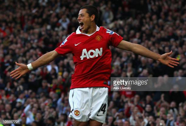 Javier Hernandez of Manchester United celebrates after scoring the first goal during the Barclays Premier League match between Manchester United and...