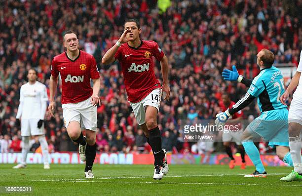Javier Hernandez of Manchester United celebrates after scoring the opening goal during the Barclays Premier League match between Manchester United...