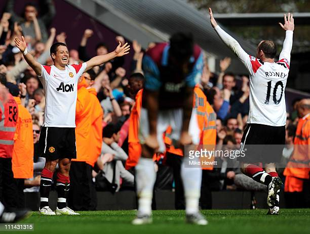 Javier Hernandez of Manchester United celebrates his goal with Wayne Rooney during the Barclays Premier League match between West Ham United and...