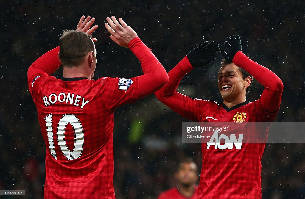 Javier Hernandez of Manchester United celebrates scoring his team's third goal with team-mate <a gi-track='captionPersonalityLinkClicked' href=/galleries/search?phrase=Wayne+Rooney&family=editorial&specificpeople=157598 ng-click='$event.stopPropagation()'>Wayne Rooney</a> during the FA Cup with Budweiser Fourth Round match between Manchester United and Fulham at Old Trafford on January 26, 2013 in Manchester, England.