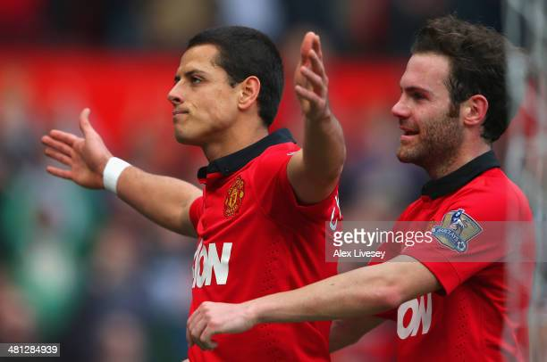 Javier Hernandez of Manchester United celebrates scoring his team's fourth goal with Juan Mata during the Barclays Premier League match between...