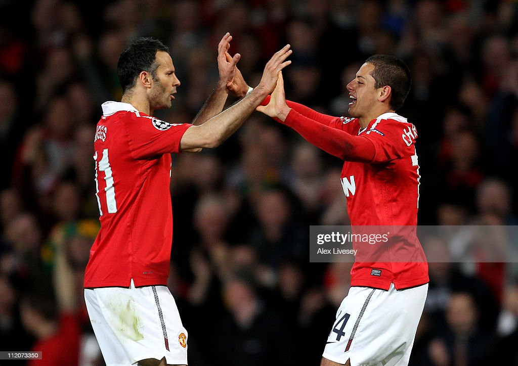<a gi-track='captionPersonalityLinkClicked' href=/galleries/search?phrase=Javier+Hernandez+-+Soccer+Player&family=editorial&specificpeople=6733186 ng-click='$event.stopPropagation()'>Javier Hernandez</a> of Manchester United celebrates scoring the opening goal with team mate <a gi-track='captionPersonalityLinkClicked' href=/galleries/search?phrase=Ryan+Giggs&family=editorial&specificpeople=201666 ng-click='$event.stopPropagation()'>Ryan Giggs</a> (L) during the UEFA Champions League Quarter Final second leg match between Manchester United and Chelsea at Old Trafford on April 12, 2011 in Manchester, England.