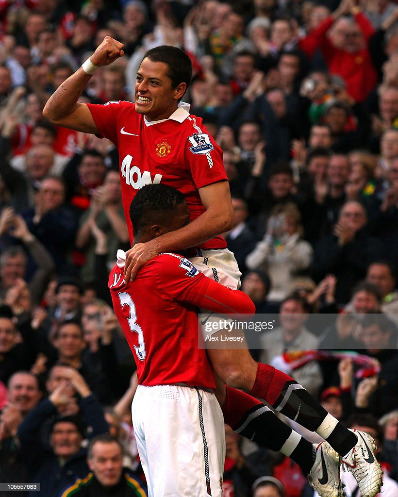 Javier Hernandez of Manchester United celebrates with <a gi-track='captionPersonalityLinkClicked' href=/galleries/search?phrase=Patrice+Evra&family=editorial&specificpeople=714865 ng-click='$event.stopPropagation()'>Patrice Evra</a> after scoring the first goal during the Barclays Premier League match between Manchester United and West Bromwich Albion at Old Trafford on October 16, 2010 in Manchester, England.
