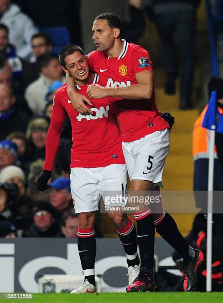 Javier Hernandez of Manchester United celebrates with team mate Rio Ferdinand as he scores their third goal with a header during the Barclays Premier...
