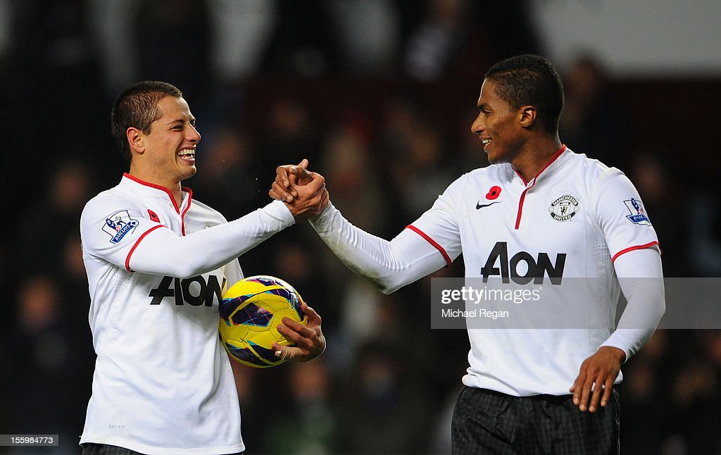 Javier Hernandez of Manchester United celebrates with team-mate Luis Antonio Valencia (R) at the end of the Barclays Premier league match between Aston Villa and Manchester United at Villa Park on November 10, 2012 in Birmingham, England.