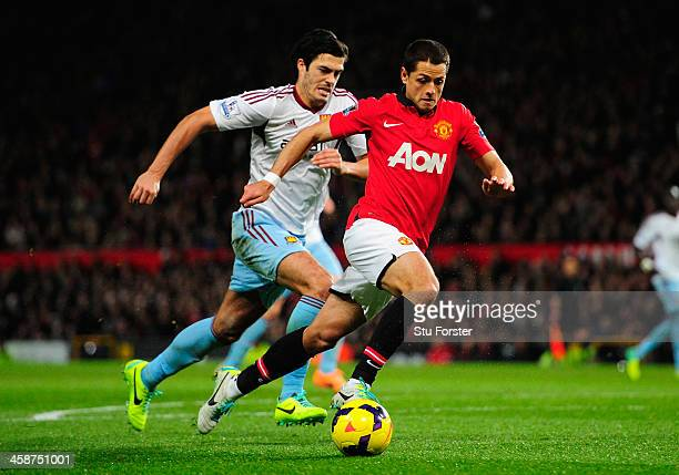 Javier Hernandez of Manchester United competes with James Tomkins of West Ham United during the Barclays Premier League match between Manchester...