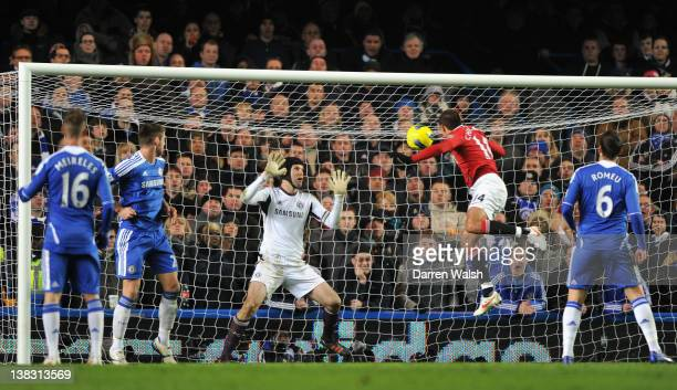 Javier Hernandez of Manchester United heads the ball past Petr Cech of Chelsea during the Barclays Premier League match between Chelsea and...