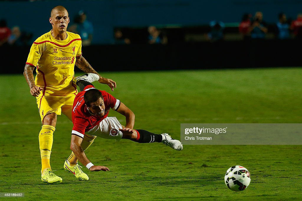 Javier Hernandez #14 of Manchester United is tackled by Martin Skrtel #37 of Liverpool in the Guinness International Champions Cup 2014 Final at Sun Life Stadium on August 4, 2014 in Miami Gardens, Florida.