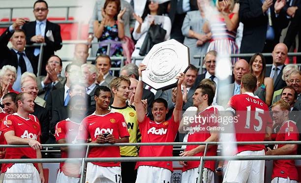 Javier Hernandez of Manchester United lifts the trophy and celebrates with team mates after victory in the FA Community Shield match between Chelsea...