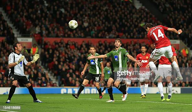 Javier Hernandez of Manchester United scores his team's third goal to make the score 32 during the UEFA Champions League Group H match between...