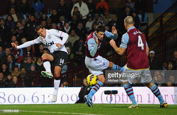 Javier Hernandez of Manchester United shoots which subsequently rebounds off Ron Vlaar of Aston Villa for his team's second and equalising goal...