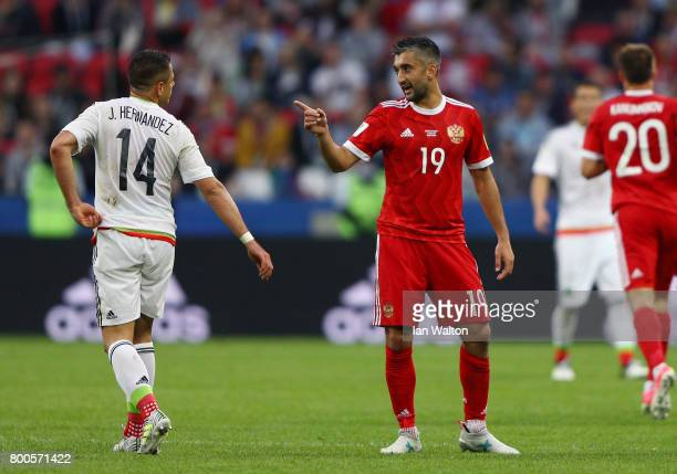 Javier Hernandez of Mexico and Alexander Samedov of Russia exchange words during the FIFA Confederations Cup Russia 2017 Group A match between Mexico...