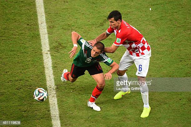 Javier Hernandez of Mexico and Dejan Lovren of Croatia compete for the ball during the 2014 FIFA World Cup Brazil Group A match between Croatia and...