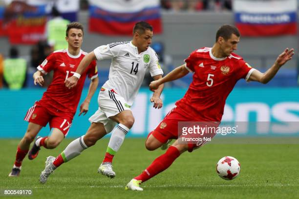 Javier Hernandez of Mexico attempts to take the ball past Viktor Vasin of Russia during the FIFA Confederations Cup Russia 2017 Group A match between...