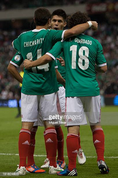 Javier Hernandez of Mexico celebrates a scored goal with his teammates during a match between Mexico and Costa Rica as part of the CONCACAF...