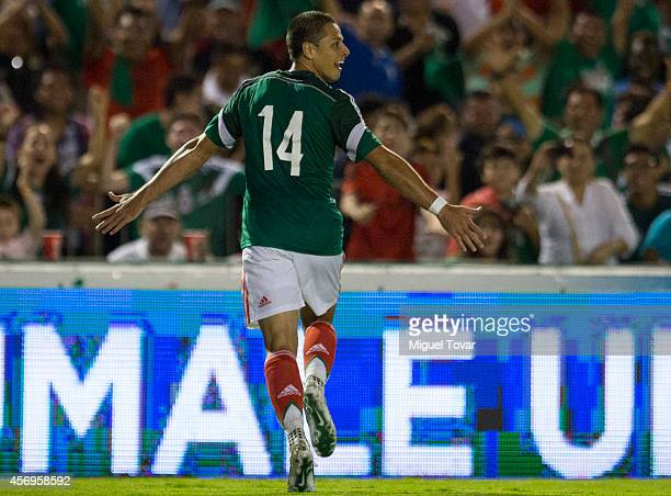 Javier Hernandez of Mexico celebrates after scoring during a friendly match between Mexico and Honduras at Victor Manuel Reyna Stadium on October 09...