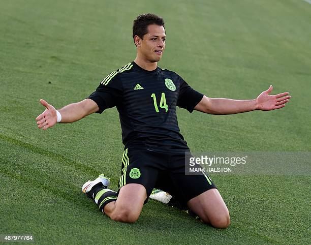 Javier Hernandez of Mexico celebrates after scoring during a friendly football match against Ecuador at the LA Memorial Coliseum in Los Angeles...