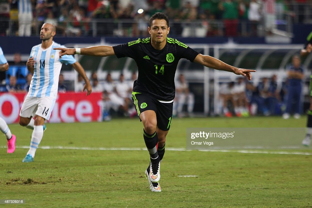 <a gi-track='captionPersonalityLinkClicked' href=/galleries/search?phrase=Javier+Hernandez+-+Soccer+Player&family=editorial&specificpeople=6733186 ng-click='$event.stopPropagation()'>Javier Hernandez</a> of Mexico celebrates after scoring the firs goal of his team during a friendly match between Argentina and Mexico at AT&T Stadium on September 08, 2015 in Arlington, United States.