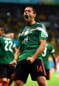 Javier Hernandez of Mexico celebrates his team's first goal by Rafael Marquez during the 2014 FIFA World Cup Brazil Group A match between Croatia and...