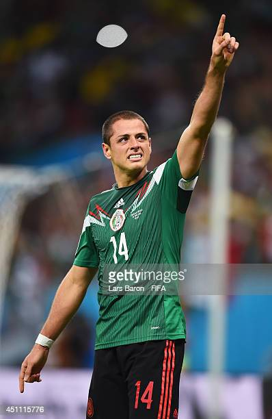 Javier Hernandez of Mexico celebrates scoring his team's third goal during the 2014 FIFA World Cup Brazil Group A match between Croatia and Mexico at...
