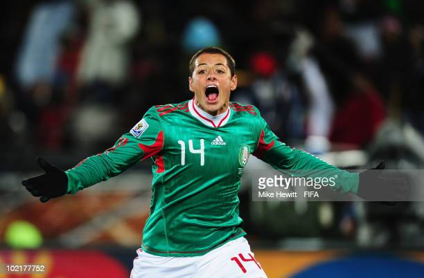 Javier Hernandez of Mexico celebrates scoring the opening goal during the 2010 FIFA World Cup South Africa Group A match between France and Mexico at...
