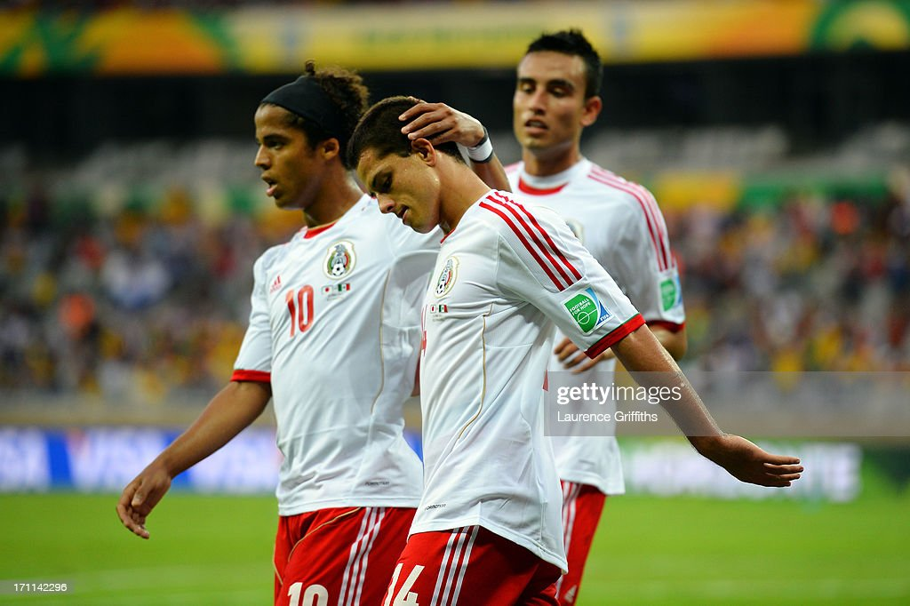 Javier Hernandez of Mexico celebrates with Giovani dos Santos of Mexico after scoring a goal in the second half against Japan during the FIFA Confederations Cup Brazil 2013 Group A match between Japan and Mexico at Estadio Mineirao on June 22, 2013 in Belo Horizonte, Brazil.