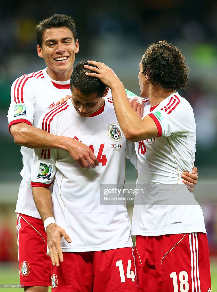 Javier Hernandez of Mexico celebrates with Hector Moreno and Andres Guardado after scoring a goal in the second half against Japan during the FIFA Confederations Cup Brazil 2013 Group A match between Japan and Mexico at Estadio Mineirao on June 22, 2013 in Belo Horizonte, Brazil.