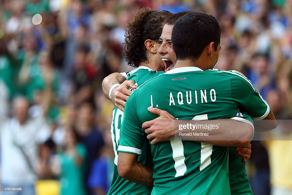 <a gi-track='captionPersonalityLinkClicked' href=/galleries/search?phrase=Javier+Hernandez+-+Soccer+Player&family=editorial&specificpeople=6733186 ng-click='$event.stopPropagation()'>Javier Hernandez</a> of Mexico celebrates with his team-mates after scoring his team's first goal from a penalty kick to make the score 1-1 during the FIFA Confederations Cup Brazil 2013 Group A match between Mexico and Italy at the Maracana Stadium on June 16, 2013 in Rio de Janeiro, Brazil.