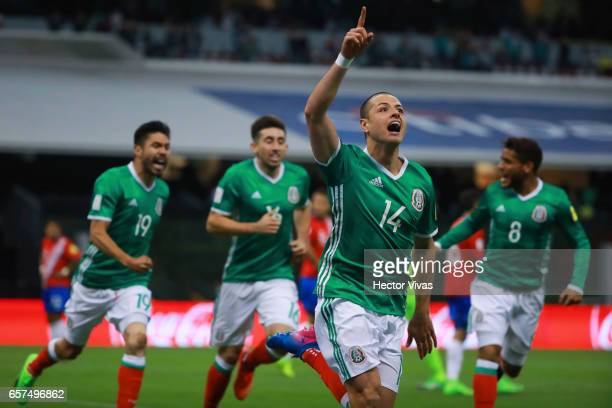 Javier Hernandez of Mexico celebrates with teammates after scoring the first goal of his team during the fifth round match between Mexico and Costa...