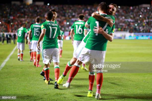 Javier Hernandez of Mexico celebrates with teammates after scoring the second goal of his team during the match between Mexico and Trinidad Tobago as...