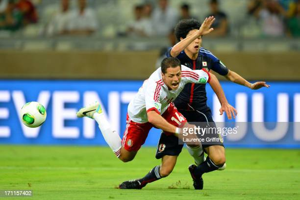 Javier Hernandez of Mexico draws the penalty against Atsuto Uchida of Japan during the FIFA Confederations Cup Brazil 2013 Group A match between...
