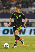 Javier Hernandez of Mexico drives the ball during a friendly match between Argentina and Mexico at ATT Stadium on September 08 2015 in Arlington...