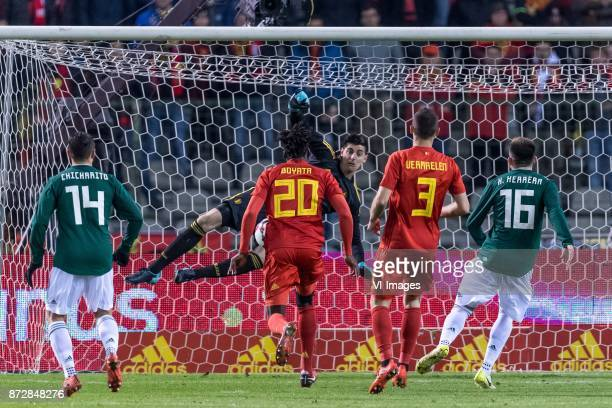 Javier Hernandez of Mexico goalkeeper Thibaut Courtois of Belgium Dedryck Boyata of Belgium Thomas Vermaelen of Belgium Hector Herrera of Mexico...