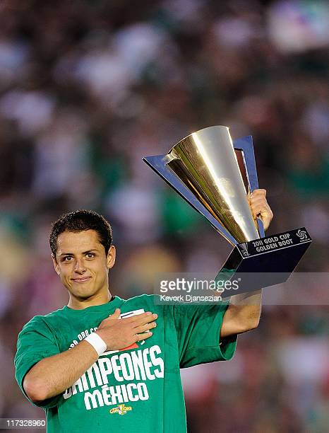 Javier Hernandez of Mexico holds the Golden Booth trophy for most goals scored in the tournament after defeating the United States in the 2011...