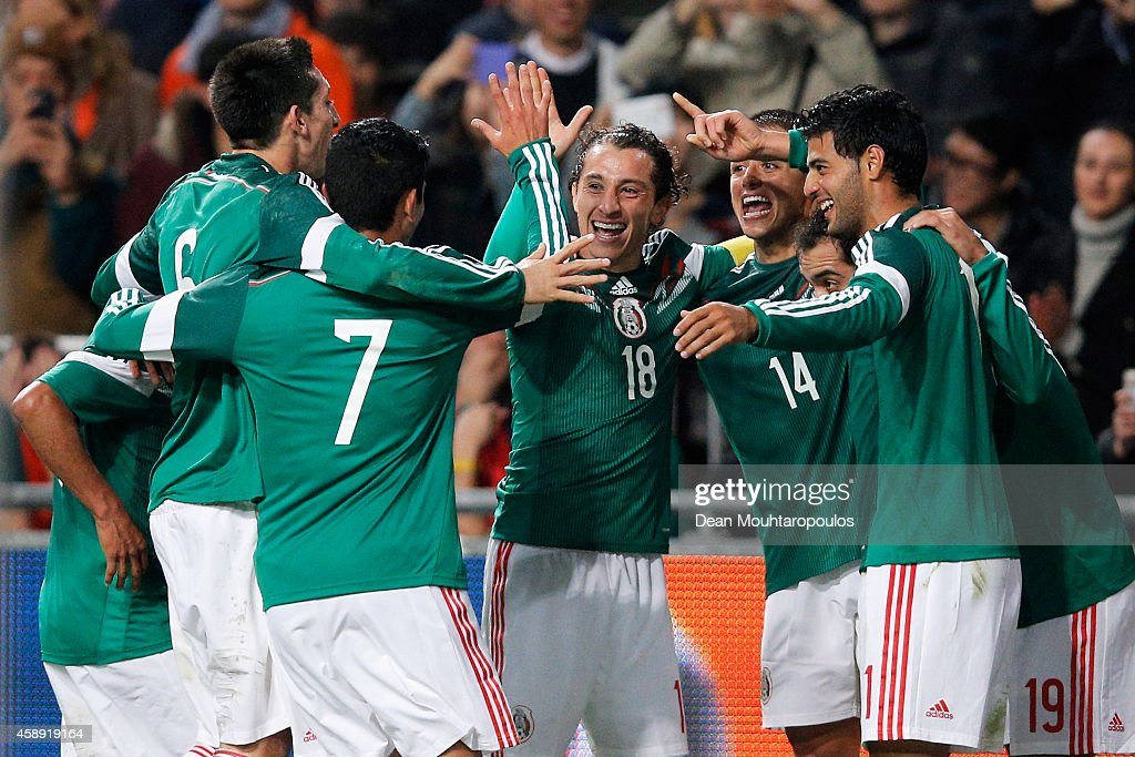 <a gi-track='captionPersonalityLinkClicked' href=/galleries/search?phrase=Javier+Hernandez+-+Voetballer&family=editorial&specificpeople=6733186 ng-click='$event.stopPropagation()'>Javier Hernandez</a> #14 of Mexico is congratulated by team mates after scoring the third goal of the game for his team during the international friendly match between Netherlands and Mexico held at the Amsterdam ArenA on November 12, 2014 in Amsterdam, Netherlands.