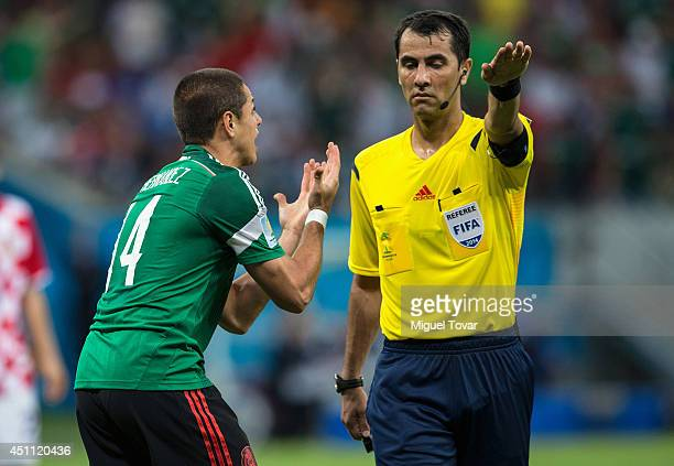 Javier Hernandez of Mexico protests to referee Ravshan Irmatov during the 2014 FIFA World Cup Brazil Group A match between Croatia and Mexico at...