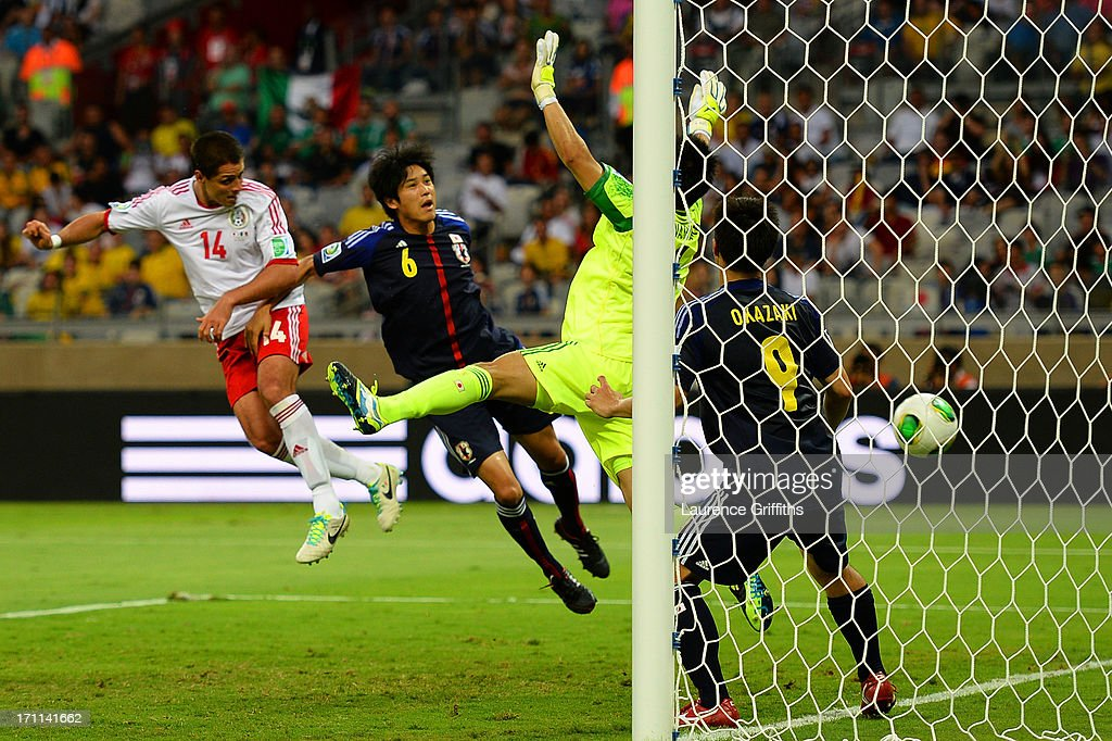 Javier Hernandez of Mexico scores a goal past <a gi-track='captionPersonalityLinkClicked' href=/galleries/search?phrase=Eiji+Kawashima&family=editorial&specificpeople=3117136 ng-click='$event.stopPropagation()'>Eiji Kawashima</a>, <a gi-track='captionPersonalityLinkClicked' href=/galleries/search?phrase=Atsuto+Uchida&family=editorial&specificpeople=4318608 ng-click='$event.stopPropagation()'>Atsuto Uchida</a> and <a gi-track='captionPersonalityLinkClicked' href=/galleries/search?phrase=Shinji+Okazaki&family=editorial&specificpeople=4320771 ng-click='$event.stopPropagation()'>Shinji Okazaki</a> of Japan during the FIFA Confederations Cup Brazil 2013 Group A match between Japan and Mexico at Estadio Mineirao on June 22, 2013 in Belo Horizonte, Brazil.
