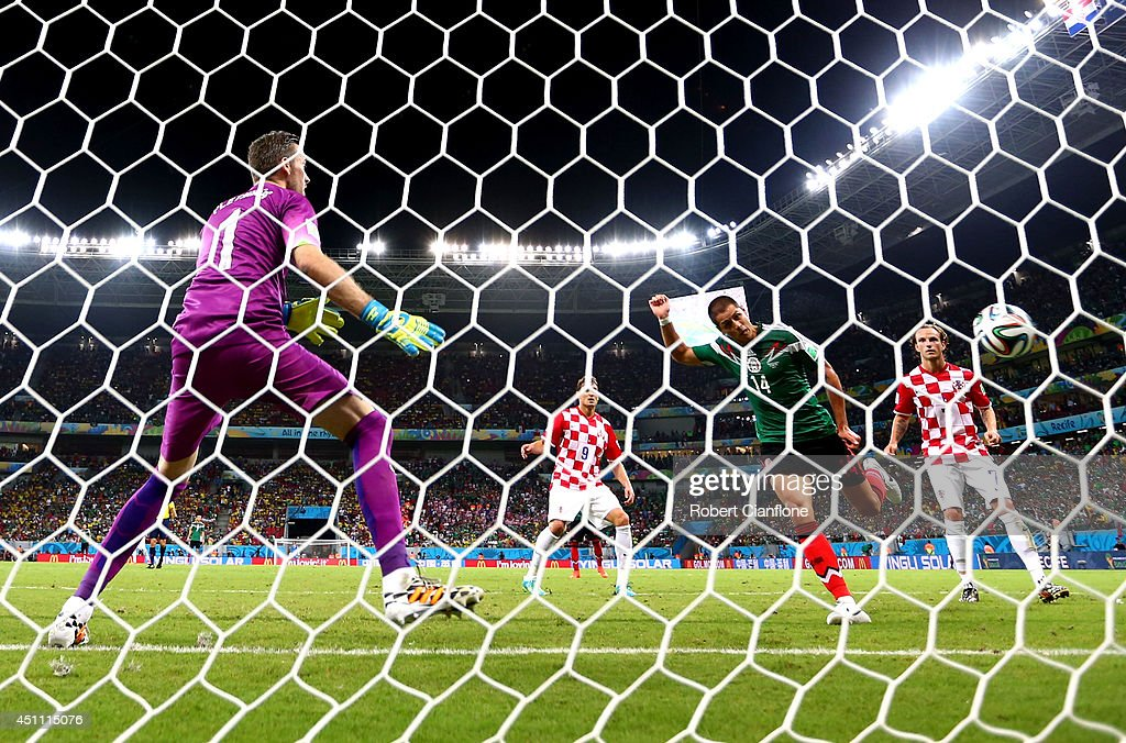 Javier Hernandez of Mexico scores his team's third goal past goalkeeper Stipe Pletikosa of Croatia during the 2014 FIFA World Cup Brazil Group A...