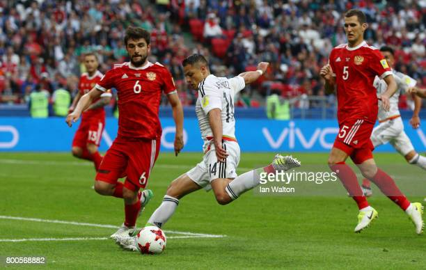 Javier Hernandez of Mexico shoots during the FIFA Confederations Cup Russia 2017 Group A match between Mexico and Russia at Kazan Arena on June 24...