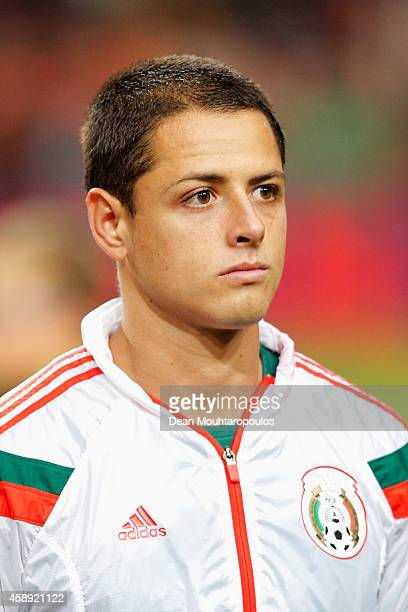 Javier Hernandez of Mexico stands for the national anthems prior to the international friendly match between Netherlands and Mexico held at the...