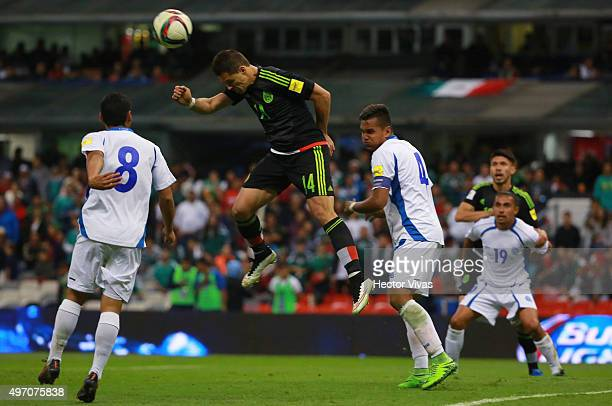 Javier Hernandez of Mexico struggles for the ball with Diego Chavarria and Henry Romero of El Salvador during the match between Mexico and El...