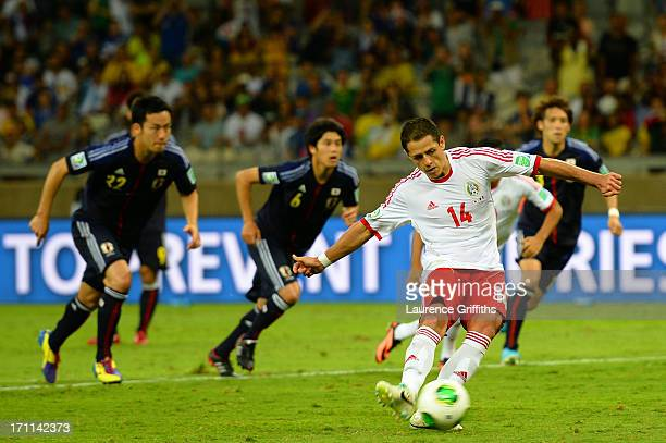 Javier Hernandez of Mexico takes a penalty shot in the second half during the FIFA Confederations Cup Brazil 2013 Group A match between Japan and...