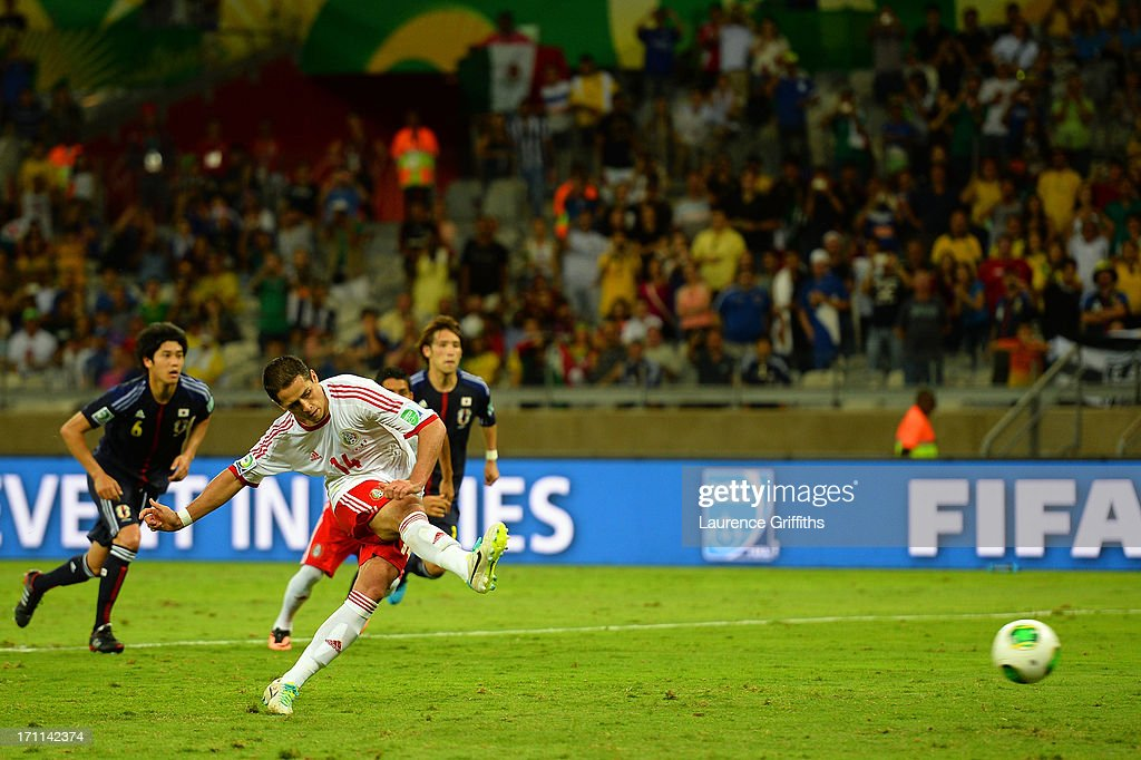 Javier Hernandez of Mexico takes a penalty shot in the second half during the FIFA Confederations Cup Brazil 2013 Group A match between Japan and Mexico at Estadio Mineirao on June 22, 2013 in Belo Horizonte, Brazil.