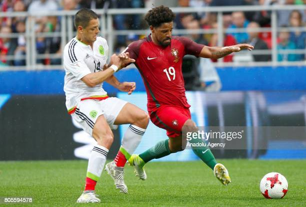 Javier Hernandez of Mexico vies with Eliseu of Portugal during the FIFA Confederations Cup Russia 2017 PlayOff for Third Place between Portugal and...