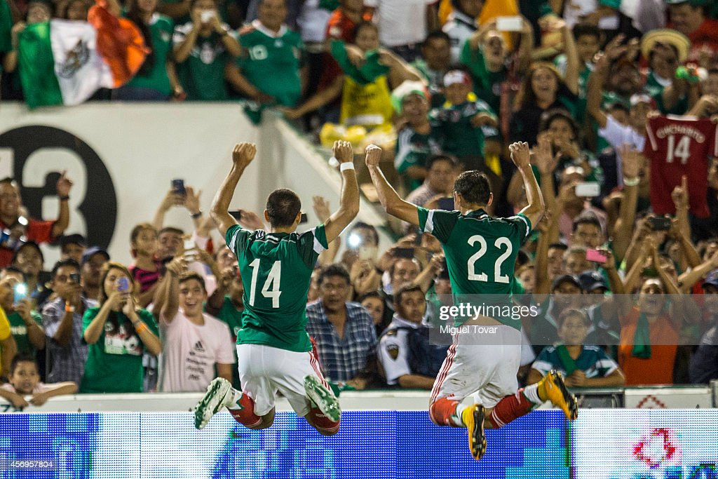Javier Hernandez of Mexico with <a gi-track='captionPersonalityLinkClicked' href=/galleries/search?phrase=Paul+Aguilar&family=editorial&specificpeople=4476672 ng-click='$event.stopPropagation()'>Paul Aguilar</a> after scoring during a friendly match between Mexico and Honduras at Victor Manuel Reyna Stadium on October 09, 2014 in Tuxtla Gutierrez, Mexico.
