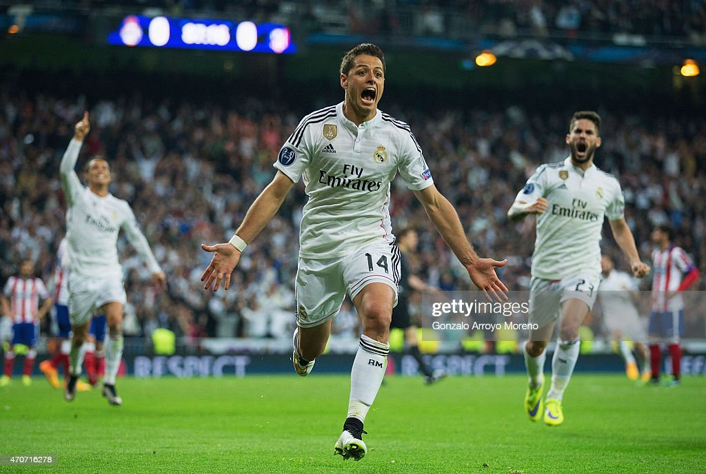 Javier Hernandez of Real Madrid CF (14) celebrates as he scores their first goal during the UEFA Champions League quarter-final second leg match between Real Madrid CF and Club Atletico de Madrid at Bernabeu on April 22, 2015 in Madrid, Spain.